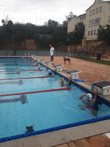 Coach Shane with Assistant Helper Fudge with Swimjozi Squad